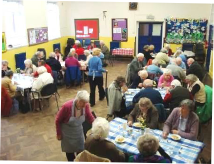 Diners tucking into pudding at the Lunch Club at Carters Lane Baptist Church